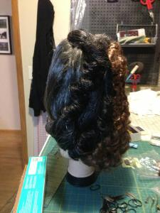 You can see the curls on the side from the wefts.  They are in the much darker color.