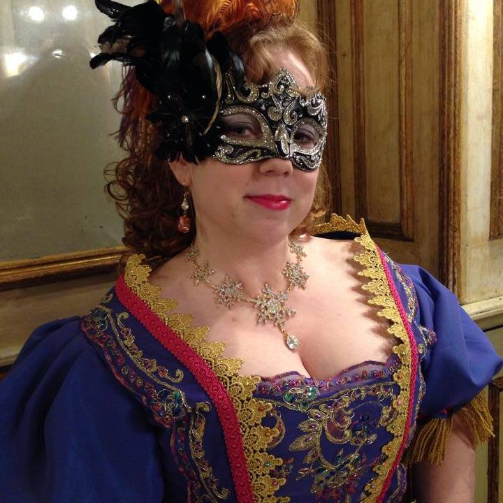 Wearing a mask given to me by Santa Carlucci, who bought it in Venice.
