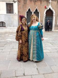 Elizabeth and I in our fantasy Italian outfits with new masks.